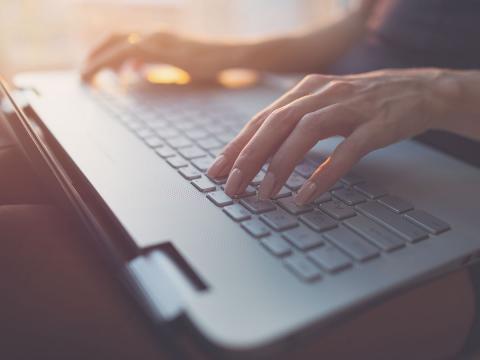 Copywriter composing text on laptop